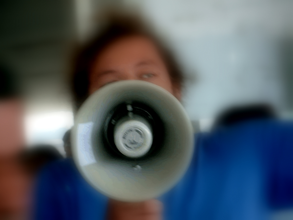 woman with megaphone, show don't tell